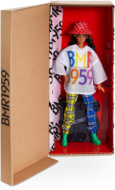 """BMR1959 celebrates the 60-year fashion legacy of Barbara """"Barbie"""" Millicent Roberts with a bold, streetwear-inspired collection that's all about personal expression and style. This fully poseable Barbie BMR1959 doll wears plaid color block jogger pants and a mesh jersey top with a rainbow logo graphic. Platform combat boots, rope twist pigtails and a bucket hat with allover logo print finish the look. Specially designed, FSC-certified shoebox packaging is made from materials that have been responsibly sourced. Each Barbie BMR1959 doll features a unique look, so you can express your style with the whole crew.  Includes BMR1959 logo doll stand for displaying."""