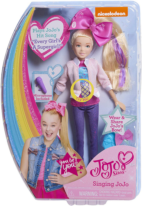 "It's JoJo with the bow bow. The Singing JoJo Doll stands 10"" tall. JoJo sings her hit song, ""Every Girl's a Supergirl."" Wears outfit inspired by JoJo's look in the music video. Includes a microphone accessory. Includes hairbrush to help style and comb JoJo's hair. Comes with wear-and-share bow accessory."