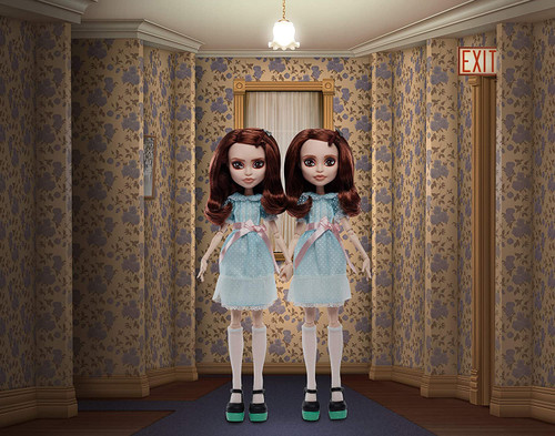 """introducing the shining grady twins collector doll 2-pack, inspired by the legendary horror film and reimagined through a scary-cool monster high filter each grady twins doll wears a blue babydoll dress with lace trim, sheer sleeves, a pleated bodice and satiny bow to-die-for details include a hatchet hair accessory, sheer stockings and a pair of platform mary-jane shoes with hedge maze-inspired heels for each 11 """"joints"""" ready these collectible dolls for killer poses - they can hold hands to recreate an iconic movie moment or hold a film-inspired accessory, like a room 237 room key additional accessories include a yellow ball and a page from jack's typewritten manuscript"""