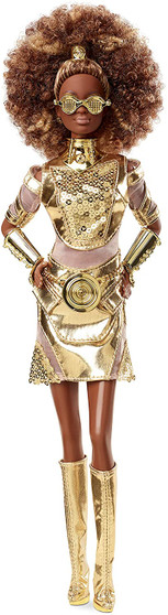 Inspired by the films' original concept art, the Star Wars x Barbie collection re-imagines iconic characters through a distinctive Barbie high-fashion filter. This Star Wars x Barbie collaboration is an homage to Star Wars: A New Hope. Star Wars C-3PO x Barbie doll evokes C-3PO's illustrious armor in a head-to-toe liquid gold look with accents of sheer organza and golden sequins. Details include a golden collar, bangles, glossy knee-high boots, glasses and brilliant cincture inspired by C-3PO's primary power coupler outlet. Star Wars C-3PO x Barbie doll makes a great gift for fans and collectors. Includes a Star Wars doll stand and Certificate of Authenticity.