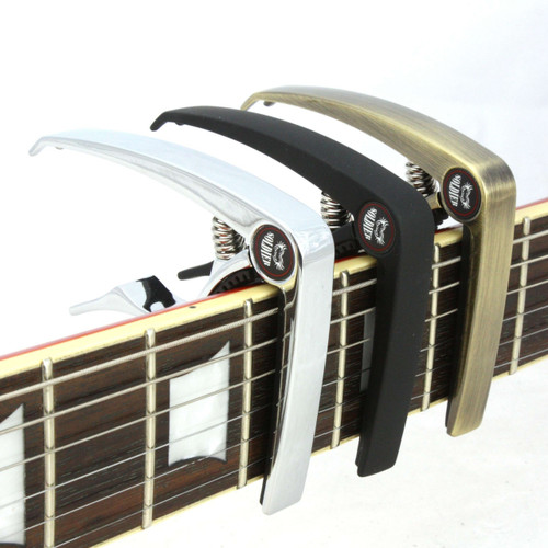Soldier guitar capos on the neck of an electric guitar (an Epiphone Les Paul).