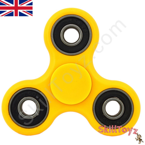 Shown with the supplied yellow finger pads fitted over the centre bearing of the spinner. Ready to play!
