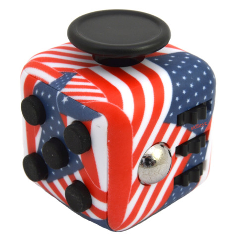 Premium Edition Fidget Cube featuring a larger body and soft touch rubberised finish. USA edition.