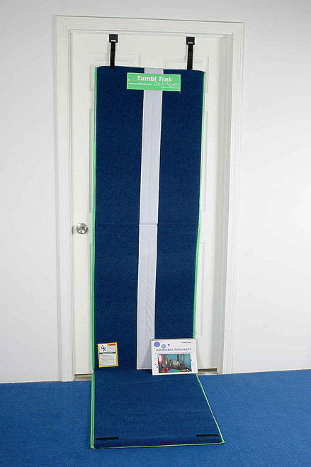 The Lime Green Handstand Homework Mat shown unfolded attached to a door.