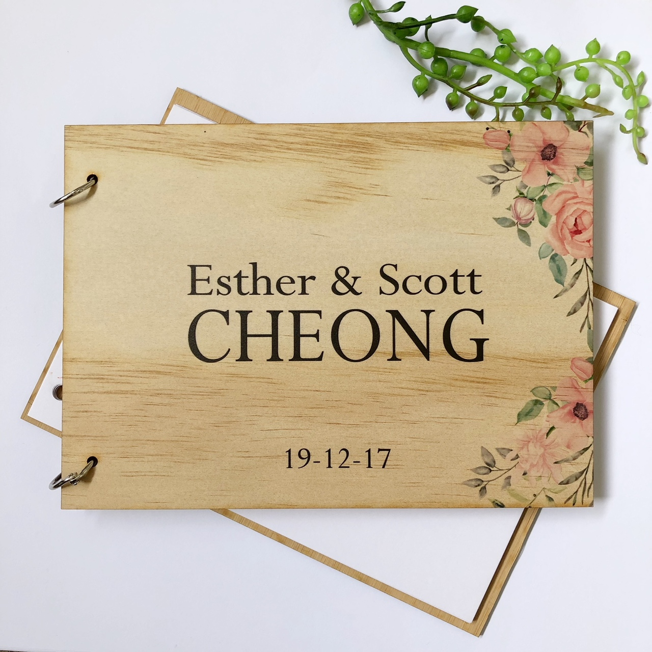 A guest book - personalised with flowers