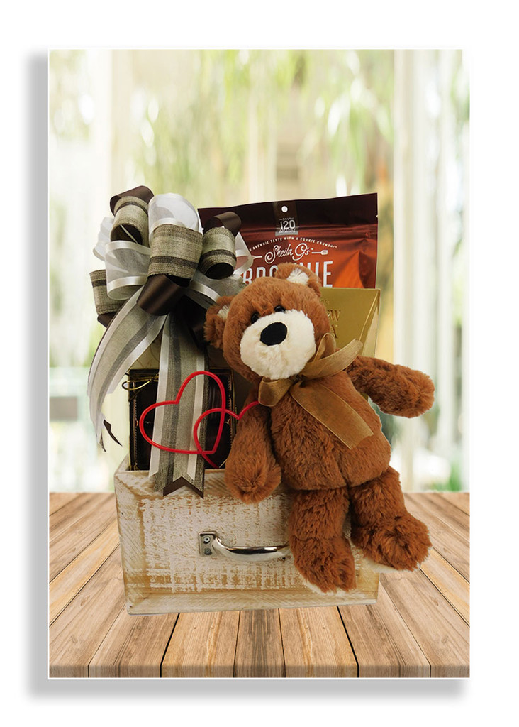 This adorable, cuddly teddy bear perched on a wood drawer will certainly bring delight! He comes with cashew roca, chocolate meltaways, SheilaG's salted caramel brownie brittle, baked cocoa coconut chips and toffee peanuts.   The wood drawer container will be enjoyed for many years to come!