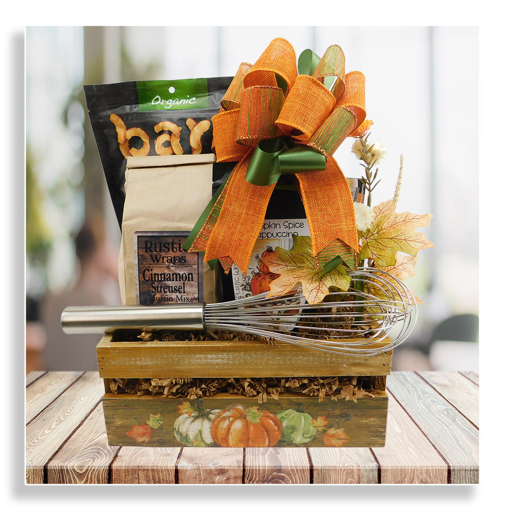 This lovely fall themed basket is a perfect seasonal gift for any occasion, and includes the following: cinnamon streusel muffin mix, whisk, pumpkin cappuccino beverage mix, dried apple chips, and pomegranate ginger super snacks.