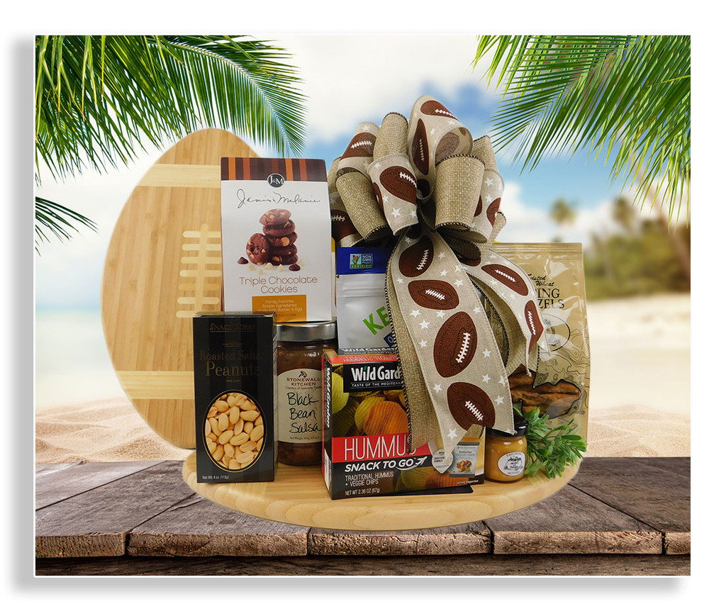If you love football, then this is the perfect gift for you! Featuring a 16x9 inch cutting board in the shape of a football and a great variety of healthy snacks: black bean chips, black bean salsa, quinoa snacks, honey pretzels, sweet and tangy dipping mustard, peanuts, cookies and a serving of veggie chips with hummus. Up to 2 bottles of 20 ounce beer or 2 bottles of wine can be added to this gift. For information how to order alcoholic beverages, please see our ordering wine and spirits page.