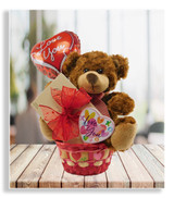 Oh, so soft and cuddly, this irresistible teddy bear is yearning to come home with you. He arrives cellophane wrapped with a delicious 1/2pound box of assorted chocolates and a pre-inflated Valentine balloon. *Please do not add any mylar balloons if you intend to ship this gift. Mylar balloon gifts must be hand delivered.