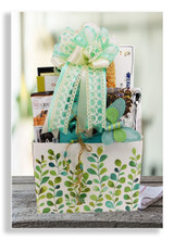 A beautiful gift box with butterfly pic is filled with special sweet offerings: butter cookies, peanut brittle, Lindt chocolates, Marich english toffee caramels, Fuji apple chips, Earl grey tea and cookie wafers. Makes a perfect gift for birthdays, get well, thinking of you, and just because.