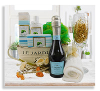 Everything about this gift promotes relaxation! Our beautiful bath and body basket* has fragrant soap, lotion, bath crystals, bath pouf, wash cloth, a mini bottle of Prosecco (one glass size) and a glass champagne flute.
