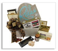 """This any occasion basket sends your friend or loved one a message to relax! Along with the chocolate chip cookies, cheese crackers, yogurt pretzels, sliced sausage, dried fruit and butter toffee caramels is a plaque that says: """"Relax. It doesn't get much better than this."""" Wine or any alcoholic beverage of your choice may be added to this gift."""