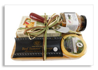 Our appetizer board has just the right kinds of goodies to pair nicely with wine. The cutting board size is 11x7x1, and showcases black olive tapenade, gouda cheese, Partners crackers, and sliced sausage. A cheese knife is also included. Our cutting boards can be engraved with your company logo and/or message (minimums are required). Please call for more details.