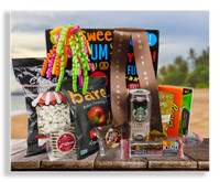 Help make their studies a little easier by sending them a few snacks and beverages to get them through the grind. This care package has white cheddar cheese popcorn, movie theater candies, Kind bars, Starbucks Double Shot energy drink, milk chocolate covered graham cracker, S'more, Bare dried apple chips, cashew crunch snack and chocolate chip cookies. Adding a personalized motivational message to the ribbon will make this gift even more special!