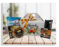 This one-of-a-kind thank you gift box was designed exclusively by our company. It includes cheese spread, crackers, nuts, snack mix and candy(substitutions can be made). You can also custom fill this box to your exact specifications.
