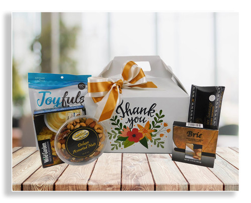 This one-of-a-kind thank you gift was designed exclusively by our company. It includes cheese spread, crackers, nuts, chocolate treats and sliced sausage (substitutions can be made). You can also custom fill this box to your exact specifications.