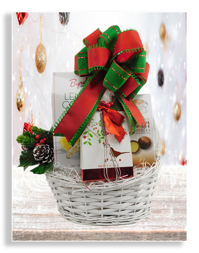A delightful holiday basket featuring cocoa and the following sweet treats: crème brulee truffles, lemon cookies, Ghirardelli peppermint bark, cinnamon with sugar cannoli chips and Pirouline wafer cookies. The cocoa mix includes a mini whisk.