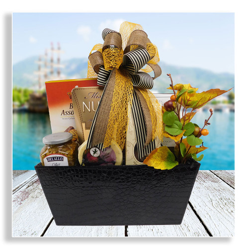 Whether you need to send a gift as a thank you, for a birthday, or just because, this versatile gift is perfect for any occasion. The recipient will enjoy an assortment of chocolate dipped biscuits, chocolates, cheese and crackers, olive bruschetta, snack mix, Sheila G's brownie crisps, and gooey caramels