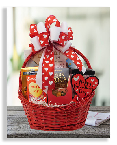 This pretty little Valentine basket brings sweets to your sweetie pie: Almond Roca, Sweethearts candies, raspberry snaps cookies, Ghirardelli squares, dark chocolate covered almonds and cranberries, s'mores bites and a box of chocolates