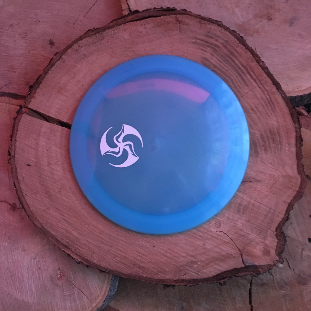 Innova Champion blue Shryke with a white Huk Lab mini TriFly stamp