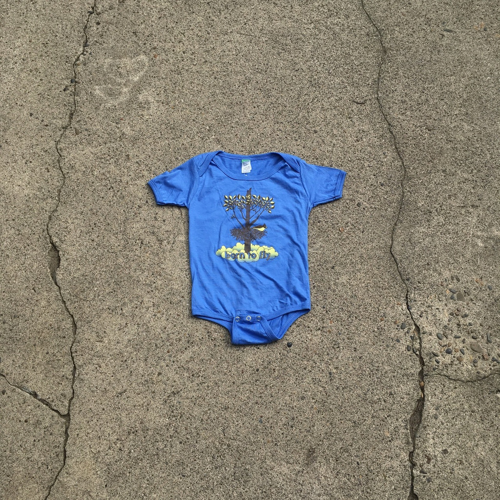 "Precious Cargo organic blue onesie with Huk Lab ""born to fly"" graphic"