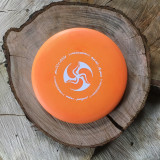 Discraft Pro D Buzzz orange with a matte white Huk Lab GEN 001 stamp