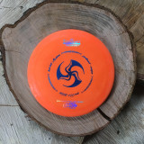 Discraft Elite X Predator orange with a blue Huk Lab GEN 001 stamp