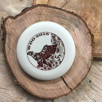Innova Pro KC Aviar with red Huk Lab Whistlin' Discs Open stamp