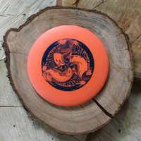 Innova DX Valkyrie orange with a blue Huk Lab GEN 002 stamp
