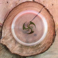 Discraft Clear Elite Z Drone with a black/ yellow checkerboard stamp