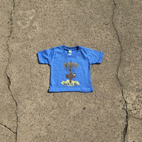 "Precious Cargo organic blue tee with Huk Lab ""born to fly"" graphic"