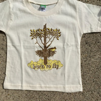 "Precious Cargo organic natural tee with Huk Lab ""born to fly"" graphic"