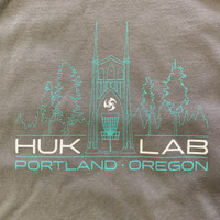 Huk Lab Pro Shop Tee Light Grey graphic close up