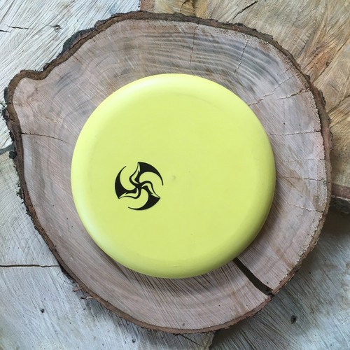 Legacy Protege Closer yellow with a black Huk Lab TriFly stamp