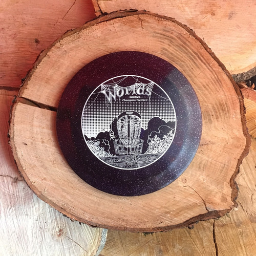 Innova Metal Flake Champion TeeDevil with a 2012 PDGA Charlotte Worlds Stamp