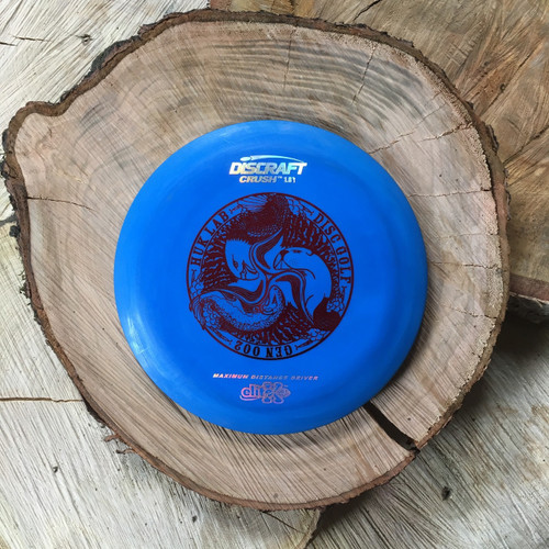Discraft Elite X Crush blue with a red Huk Lab GEN 002 stamp