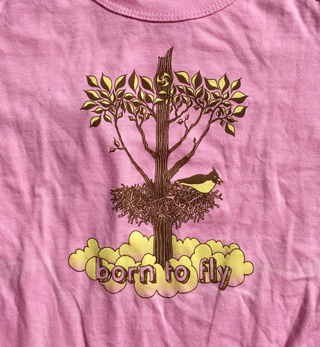 "Precious Cargo organic pink onesie with Huk Lab ""born to fly"" graphic close up"