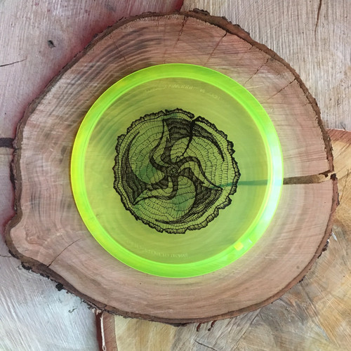 Discmania C-Line MD3 neon yellow with a black Huk Lab Timber stamp