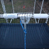 Aluminum clip hitch 25mm on a 20mm PVC pipe securing a cat enclosure to the ground with a rope and a ground peg
