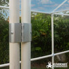25mm aluminum hinge clipped onto 25mm PVC pipe with an outside diametre of 33.40mm from Klever Cages. The hinges are part of a door for a garden frame protecting a garden