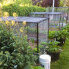Black PVC pipe connected to connectors from Klever Cages making a garden frame to protect vegetables and herbs with bird exclusion netting