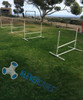 4 jumps set up in a dog agility course. Made from PVC connectors and pipe from Klever Cages