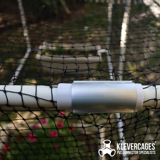25mm Aluminium Grip Clamp on top of a Snap Clamp holding Bird netting tight on a PVC garden frame protecting plants from pests