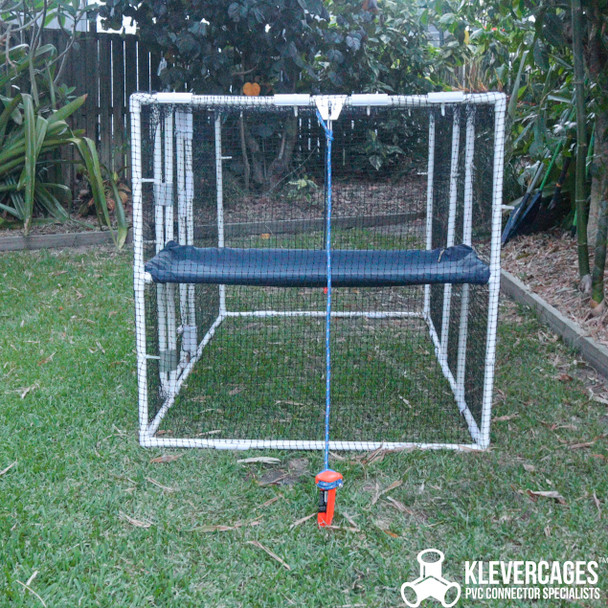 Cat enclosure built with 20mm PVC pipe and connectors from Klever Cages secured to the ground with ground pegs, rope and clip hitch