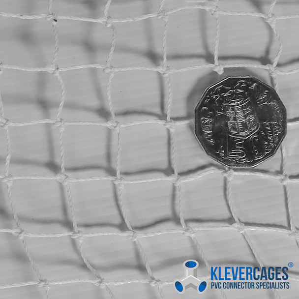 1.8m wide white bird netting knotted with an Australian 50 cent coin to show the size comparison of the 19mm square holes
