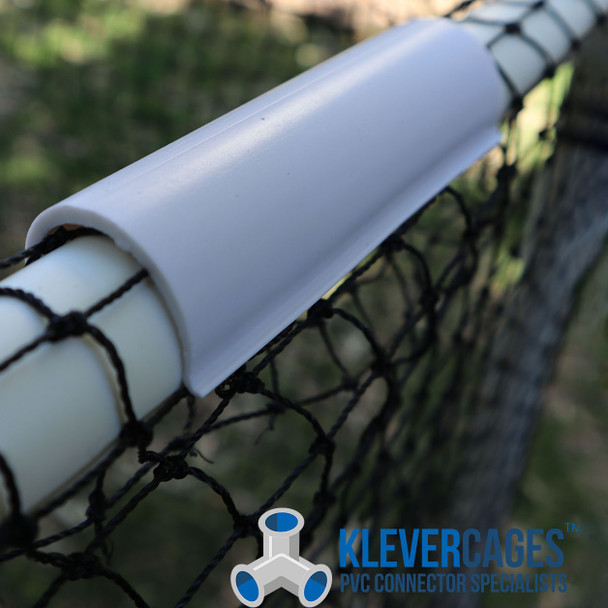 Snapclamp in use over a PVC pipe attaching Heavy duty knotted netting on a cat enclosure. Can also be used for chicken tractors, garden protection cages and cat enclosures.