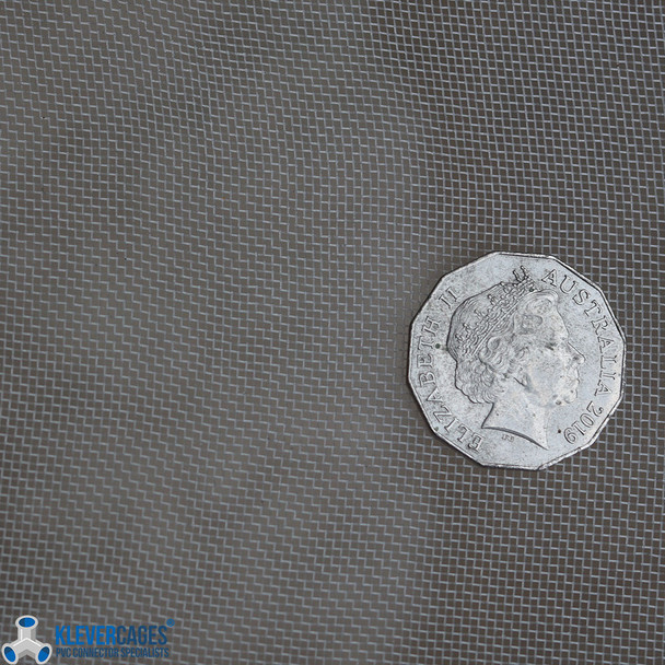 White fine mesh netting from Klever Cages used to protect vegetables and fruit trees when growing. Australian fifty cent coin on the mesh for size representation.
