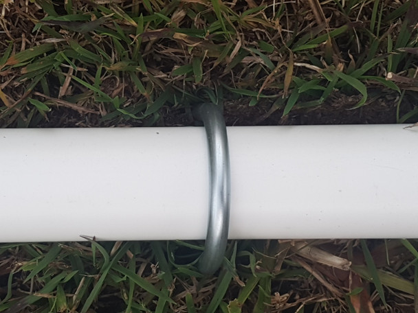 Klever Cages U-Peg in use over a PVC pipe