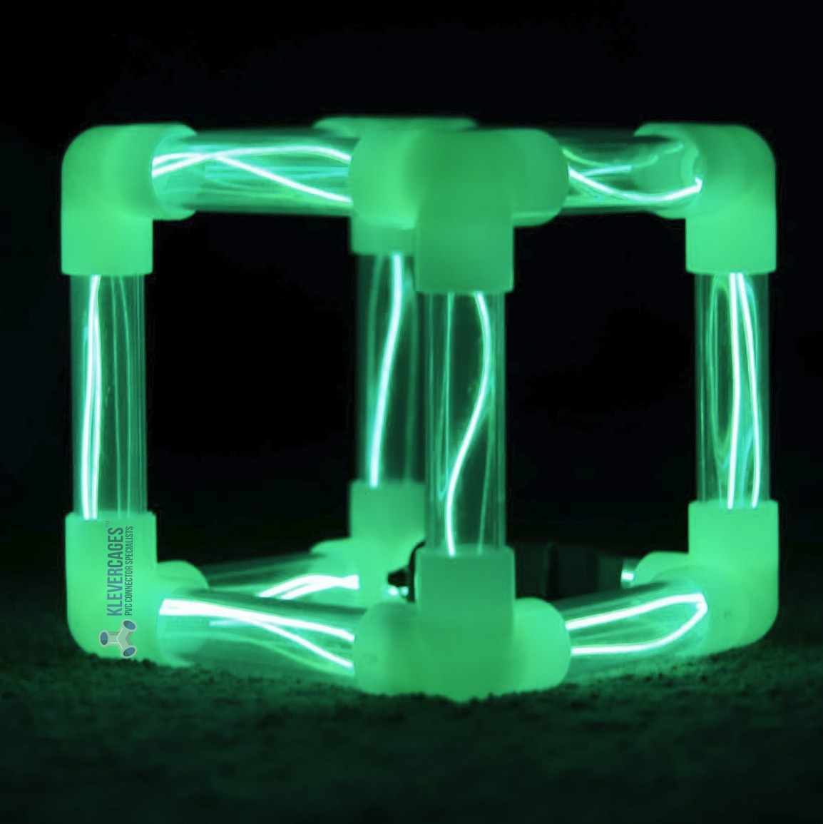 Green glow in the dark cube built with connectors that fit PVC pipe from Klever Cages. Clear pipes inserted with LED lights and glow in the dark 3way connectors