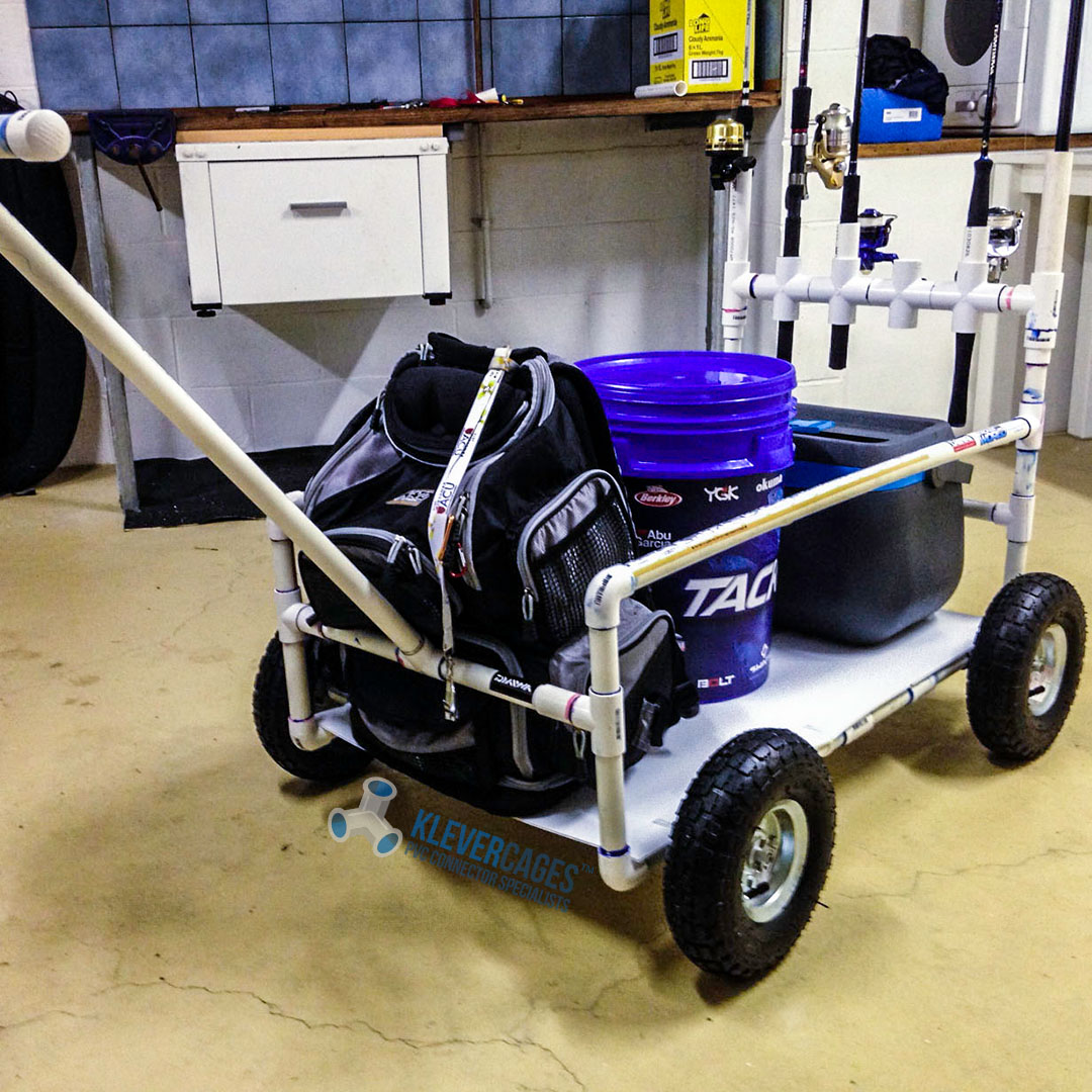 Diy beach cart built with PVC pipe and connector fittings from Klever Cages carrying a backpack and fishing gear